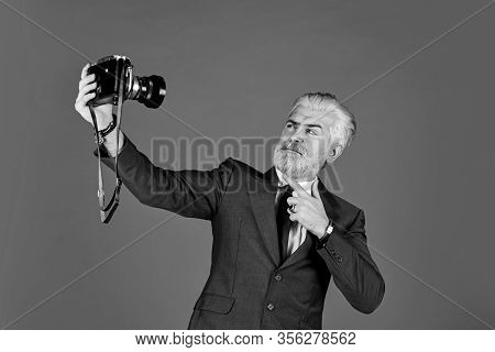 Used Goods Store. Man Cheerful Bearded Hipster Photographer. Photographer Eccentric Guy With Slr Cam