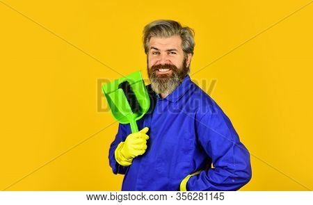 Man Cleaning Home With Broom. Janitor Man Sweeping. Spring Cleaning. Cleaning Service People. Mature