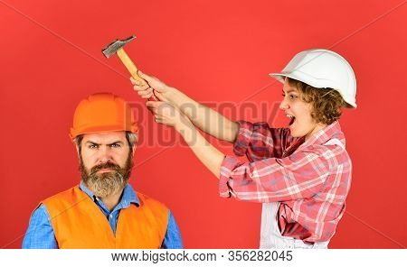 Couple Making Repair At Home. Man And Woman Wear Safety Helmet. Home Renovation. Rub In. Couple Knoc