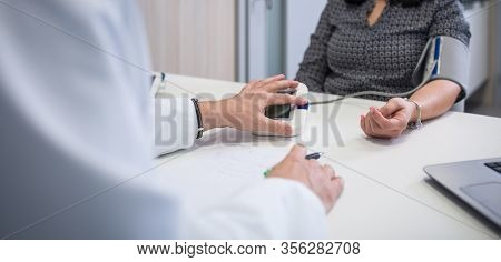 Blood pressure health check , High Blood Pressure check blood pressure of a patient in hospital, selective focus, shallow DOF