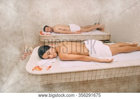 Beautiful Couple Spent Leisure Time In A Turkish Bath. Hot Steam Warmed The Bodies Of A Man And A Wo