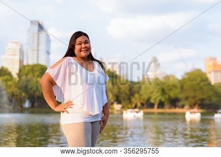 Beautiful Overweight Asian Woman Relaxing At The Park
