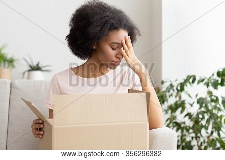 Disappointment In Online Shop. Frustrated African American Woman Presses Her Hand To Forehead