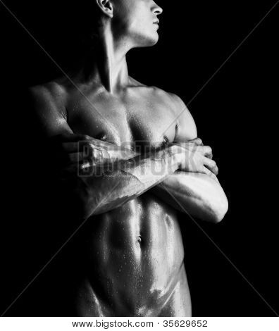 Close-up studio portrait of a young muscular nude man
