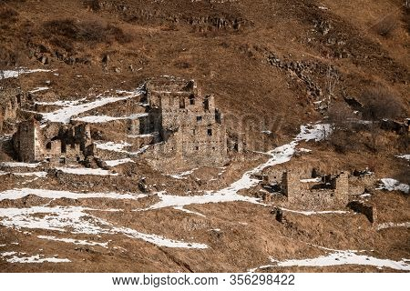 Old Antique Abandoned City In Winter Mountains.