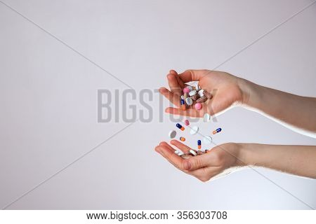 A Lot Of Colorful Levitation Medication And Pills Sprinkle In Hands. Taking Your Medication.
