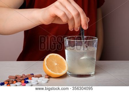 Woman Dissolves Medicine With Soluble Sachet In Water. Soluble Powder Drug Dissolved In Water. Heada