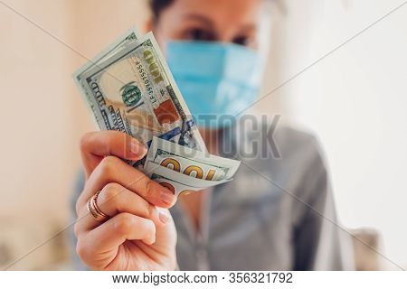 Coronavirus Covid-19 Pandemic Pharmacy Profit On Medical Masks. High Prices For Medicine. Woman Hold