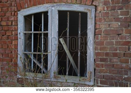 A Window In A Ruined House, The Decline Of The Economy Shows Dilapidated Buildings And Ruined Window