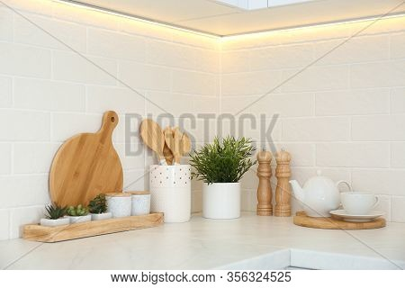 Kitchenware And Houseplant On Countertop In Modern Kitchen