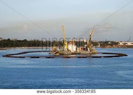 The Industrial Scenery Inside Nassau Harbour At Dusk (nassau, Bahamas).