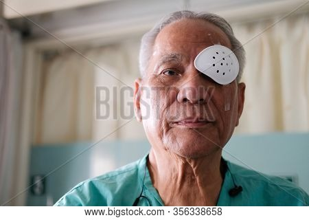 Patient Covering Eye With Protective Shield & Medical Plaster After Eyes Cataract Surgery In Hospita