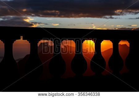 Black Silhouette Of Balustrade On Sunset And Mountain Line Backgound