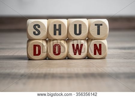 Cubes And Dice With Word Shutdown And Lockdown On Wooden Background