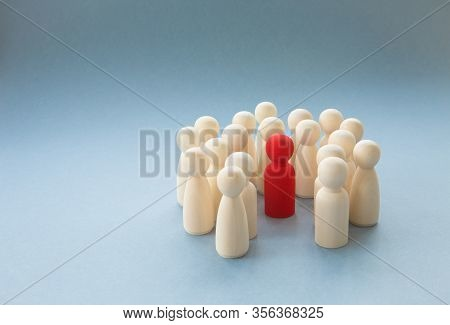 A Socially Diverse Person Being Surrounded And Protected By A Crowd Of People For Being Different.