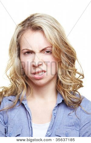 Angry blonde young woman clenching her teeth