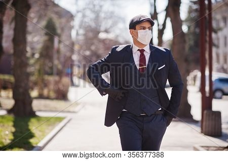 Concept Of Coronavirus Quarantine. Business Man Wear On Suit With Medical Face Mask. Mers-cov, Novel