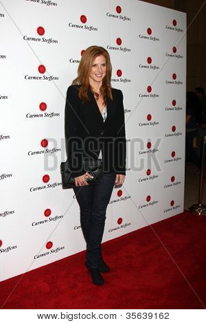 LOS ANGELES - AUG 2:  Sarah Rafferty arrives at the Carmen Steffens West Coast Flagship Store Opening at Hollywood & Highland on August 2, 2012 in Los Angeles, CA