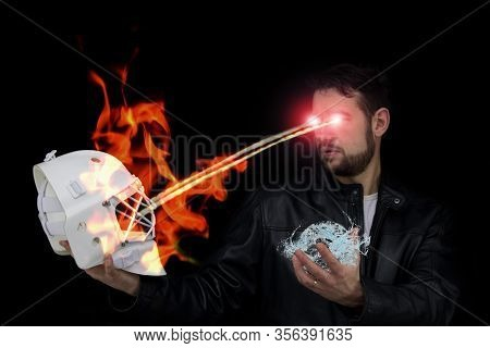 The Man Holds The Mask Of The Hockey Goalie, The Laser Beams Whip From His Eyes And Holds A Water Ba