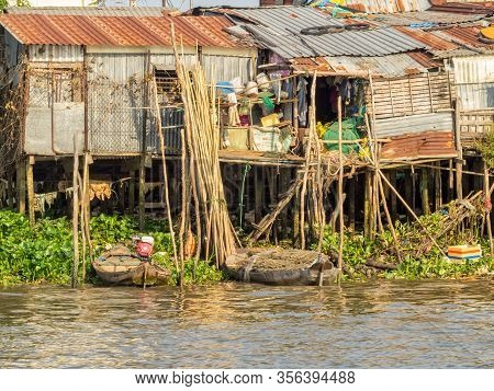 Can Tho, Vietnam - February, 3, 2016: Shacks On Stilts Along The Hau River In The Mekong Delta
