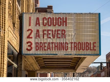 Cinema Billboard With Three Main Symptoms Or Signs Of A Coronavirus Or Covid-19 Infection Of Coughin
