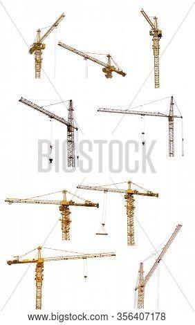 set of yellow hoisting cranes isolate on white background