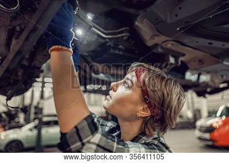 Young Female Gazing At A Lifted Auto