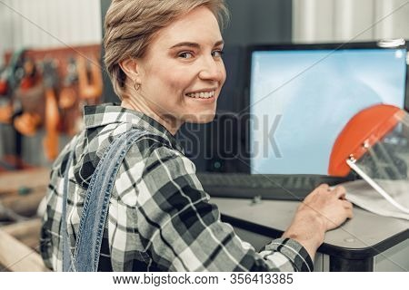 Joyous Automotive Technician Sitting At A Desk