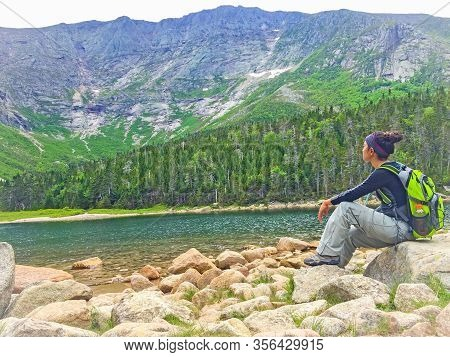 Woman Enjoying The Beautiful View Of Jordan Pond In Acadia National Park In Maine Usa