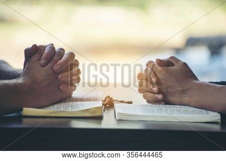 Pray And Bible Concept.asian Female Praying,hope For Peace And Free From Disease,hand In Hand Togeth