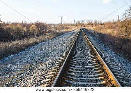 Railroad Tracks In The Spring. Railroad Go Towards The Factory