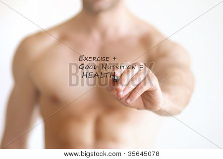Concept photo of a fit young shirtless man writing the formula for good health on transparent board that reads