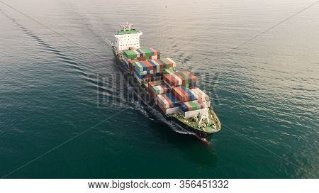 Large Container Ship At Sea. Aerial Top View Of Cargo Container Ship Vessel Import Export Container