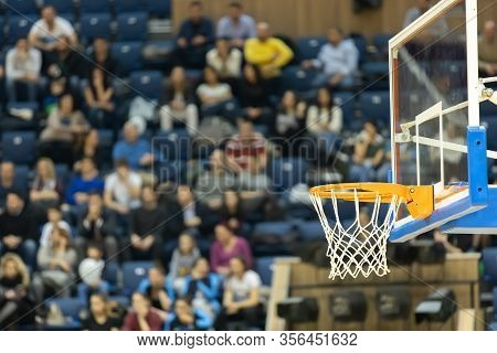 Basketball Board And Basket With Fans In The Background. Basketball Basket In The Background Of The