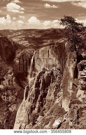Yosemite mountain ridge with waterfall in BW.