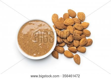 Almond spread. Almonds and butter isolated on white background.