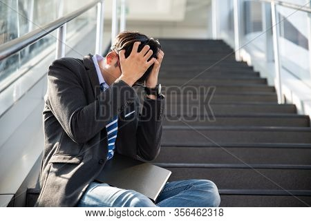 Businessman Lost In Depression Crying Sitting On Ground Street Stairs Suffering Emotional Pain Sadne