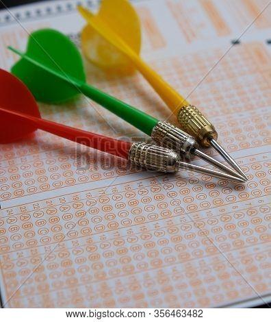 Exam Paper, Dart And Exam Pen Eraser Together,