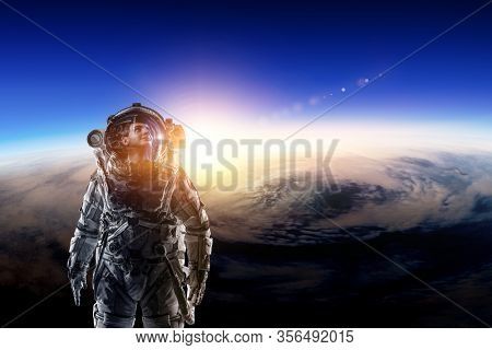 Astronaut in space on planet orbit.