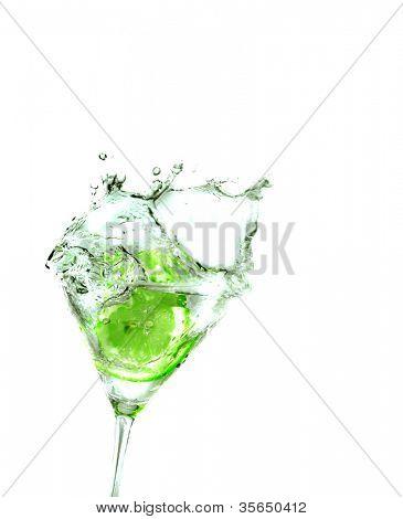 splashing llime into a martini glass