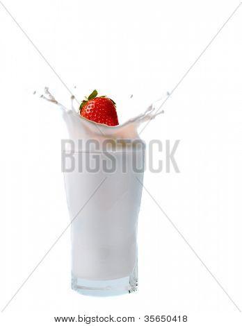 splashing strawberry into a milk glass