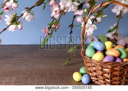 Easter Background. On A Wooden Table Basket With Colorful Easter Eggs. Bright Easter Background. Con