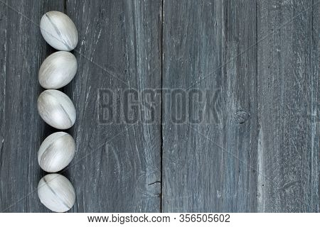 Happy Easter. Painted Eggs On Wooden Table. Top View. Copy Space For Text.