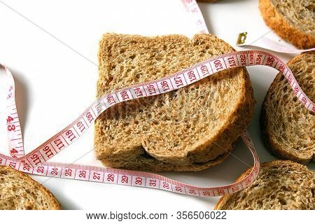 Sliced Wholemeal Bread On A White Background,