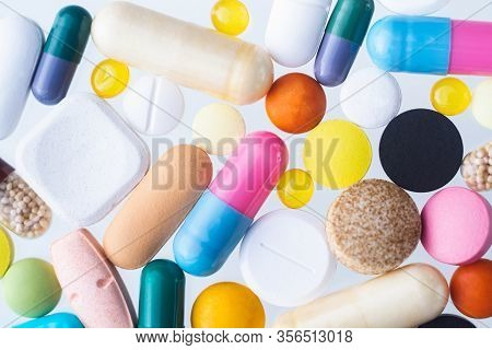 Colorful Assorted Pills Pattern On White Background