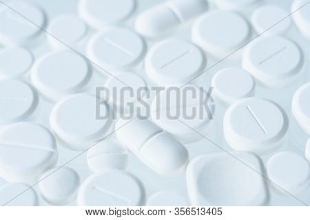 White Assorted Pills Pattern Above Light Background