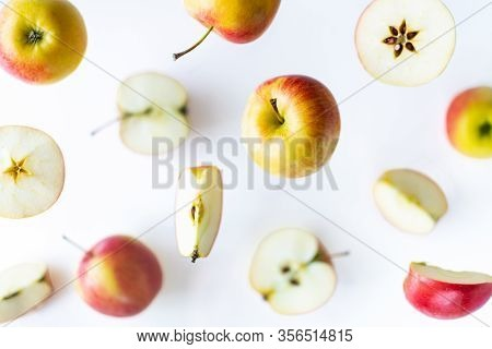 Sliced Red Apples Flying Above White Background, Levitation Effect