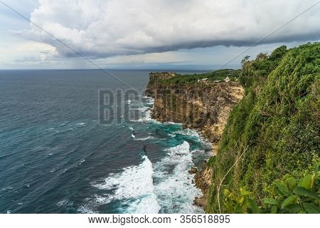 Panoramic View Of Uluwatu Temple Seen From Karang Boma Cliff Before The Storm In Bali, Indonesia