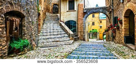 Traditional medieval villages of Italy - picturesque old floral streets. Casperia, Rieti province