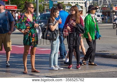 Barcelona, Spain - May 16, 2017: Unknown Young Women Stand On The Crosswalk In Port Vell In Center O